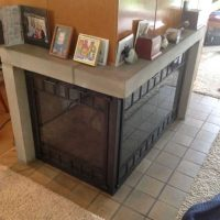 Fireplace after replaced outdated screen with Stoll doors