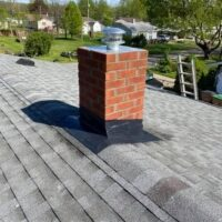 A chimney with a new point and crown.