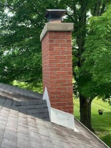 A chimney with a new cap and crown.